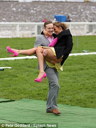 A couple have fun at last year's Grand National