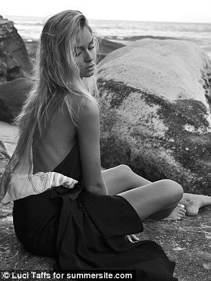 Nailing the brief! The blonde beauty nailed the 'mermaid in the city' brief as she sat cross legged on the rocks over-looking the ocean at Tamarama Beach