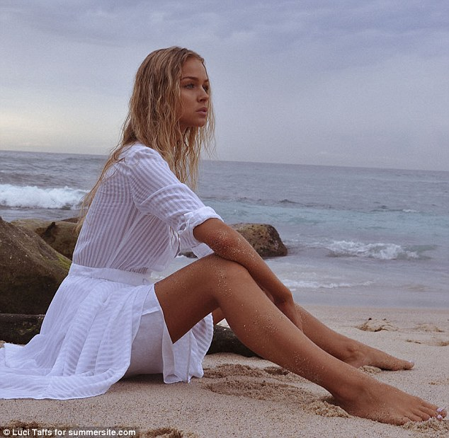 Leggy lady! Sitting on the sand Renae showed off her slender legs and arms in the partially see-through dress