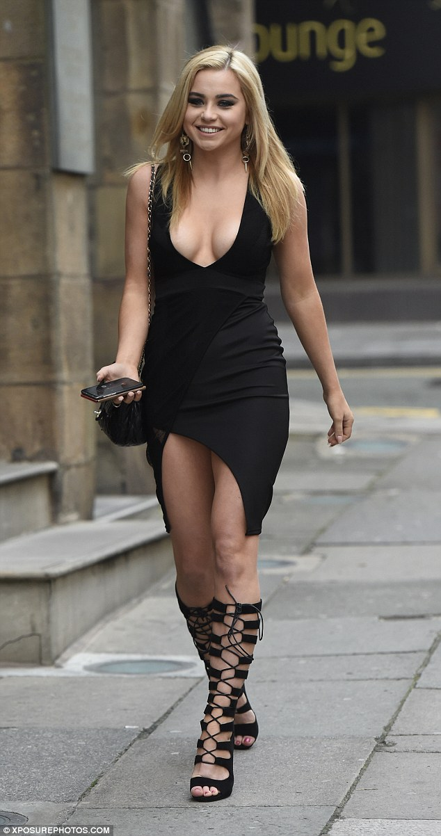 All in black: Melissa Reeves wore strappy knee-high shoes and an LBD for her day outfit