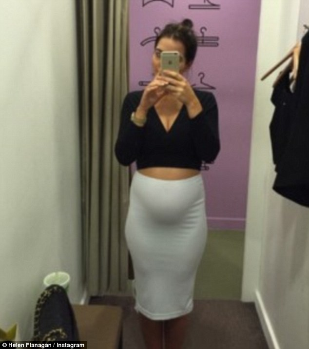 Trying things on: Helen decided against this white skirt, deciding that it was a little too much with her bump on show