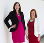 In this photo taken April 1, 2015, Jen Psaki,, right, and Katie Fallon, pose at the White House in Washington. Communications director Jen Psaki and legislative affairs director Katie Beirne Fallon say Obama has pledged to support them as they start their families while working on his senior team. Psaki is expecting a daughter in July and Fallon is scheduled to give birth to identical twin boys in May.  (AP Photo/Evan Vucci)