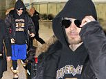 """Jared Leto arrives at Pearson International Airport in Toronto, Canada on Easter Sunday. Jared Leto is back in Toronto to begin filming his new movie """"Suicide Squad"""" where he will play the iconic role of The Joker. Jared Leto flew in from Minsk, Belarus where his band, Thirty Seconds To Mars just finished their European Tour. The band also played several shows in Russia. Jared had some strange fashion going on; wearing a black winter jacket, an Innercity Raiders hoodie, aviator sunglasses, blue Under Armour shorts with black sweatpants underneath, and winter boots. Jared Leto has also grown his beard back, which he originally shaved off for """"Suicide Squad"""", and was covering his blonde hair with his hood. """"Suicide Squad"""" also stars Will Smith, Margot Robbie, Cara Delevinge, Joel Kinnaman, Scott Eastwood, Jai Courtney and Viola Davis.\n\nPictured: Jared Leto\nRef: SPL990158  050415  \nPicture by: S Fernandez  / Splash News\n\nSplash News and Pictures"""