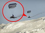 **PLEASE USE CORRECT BYLINE** PIC BY STUNT FREAKS TEAM / CATERS NEWS - (PICTURED Finnish stunt performer, Antti Pendikainen soaring through the air with a parachute attached to his snowmobile - in Riksgrnsen in Sweden)  Weve all seen paragliders soar through the air and snowmobiles blast through the snow but this thrill-seeker has combined the two - creating a paragliding snowmobile. Captured on camera, this adrenalin fuelled footage shows the moment a daredevil driver took to the skies after racing his snowmobile off the edge of a mountain. Instead of plummeting 1500 metres to his death, Finnish stunt performer, Antti Pendikainen, defied gravity by floating effortlessly above the snowy peaks of Riksgrnsen in Sweden thanks to a parachute attached to the vehicle. SEE CATERS COPY