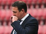 Wigan Athletic Manager Malky Mackay looks dejected as he stands in the technical area