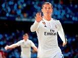 Real Madrid's Cristiano Ronaldo celebrates his goal against Granada during their Spanish first division soccer match at Santiago Bernabeu stadium in Madrid, April 5, 2015. REUTERS/Juan Medina