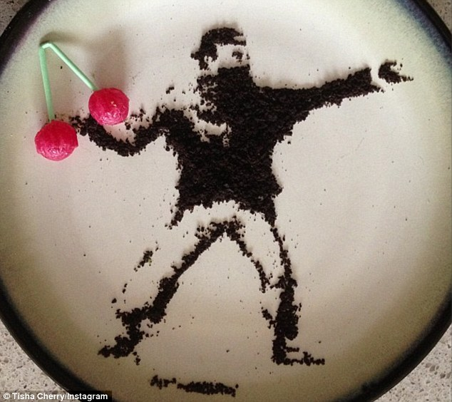 Crumbs! Ms Cherry has replaced the bouquet of flowers from Banksy's original Flower Thrower work, with a bunch of her own namesake candy fruit, crafted using only the remnants of an Oreo