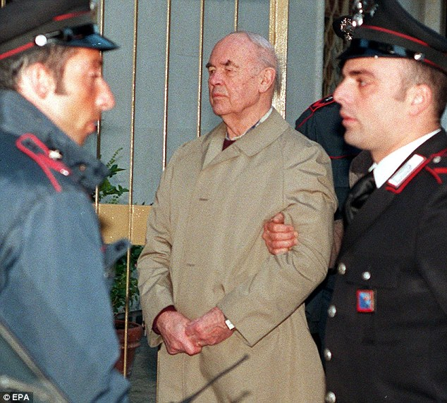 Appeal: Priebke is escorted by police as he is transferred to the Forte Boccea military prison in Rome in the 1990s