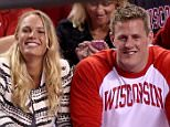 INDIANAPOLIS, IN - APRIL 06:  Tennis player Caroline Wozniacki and J.J. Watt of the Houston Texans look on from the crowd in the first half of the game between the Duke Blue Devils and the Wisconsin Badgers during the NCAA Men's Final Four National Championship at Lucas Oil Stadium on April 6, 2015 in Indianapolis, Indiana.  (Photo by Joe Robbins/Getty Images)