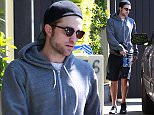 West Hollywood, CA - 'Twilight' star Robert Pattinson seems to be spending all his free time pumping iron as of late, either to beef up for his new role on 'The Walking Dead' or to look good for his upcoming wedding! R-Patz is reportedly engaged to his girlfriend of a little over a year, FKA Twigs. The scruffy Brit was spotted heading out after another session with his personal trainer on Monday, a beautiful woman who followed Robert out shortly afterwards.\nAKM-GSI        April 6, 2015\nTo License These Photos, Please Contact :\nSteve Ginsburg\n(310) 505-8447\n(323) 423-9397\nsteve@akmgsi.com\nsales@akmgsi.com\nor\nMaria Buda\n(917) 242-1505\nmbuda@akmgsi.com\nginsburgspalyinc@gmail.com