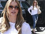 Picture Shows: Sofia Vergara  April 06, 2015\n \n 'Modern Family' actress Sofia Vergara spotted out shopping at Saks Fifth Ave in Beverly Hills, California. Sofia kept it casual in a white long sleeve top, ripped three quarter length jeans, and black platform heels.\n \n Non Exclusive\n UK RIGHTS ONLY\n \n Pictures by : FameFlynet UK © 2015\n Tel : +44 (0)20 3551 5049\n Email : info@fameflynet.uk.com