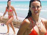 Kelly Bensimon in a red triangle top bikini in Miami Beach, FL. \n\nPictured: Kelly Bensimon\nRef: SPL992887  060415  \nPicture by: Splash News\n\nSplash News and Pictures\nLos Angeles: 310-821-2666\nNew York: 212-619-2666\nLondon: 870-934-2666\nphotodesk@splashnews.com\n