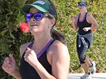 "Picture Shows: Reese Witherspoon  April 06, 2015\n \n 'Wild' star Reese Witherspoon goes for a jog with a friend before her morning yoga class in Brentwood, California.\n \n Reese recently shared the results of her hard work at the gym with a swimsuit picture she posted to Instagram last Friday. In the picture, Reese lounged in an inflatable pool donut (with sprinkles!) and captioned it ""#DonutWorryBeHappy?!""\n \n Exclusive - All Round\n UK RIGHTS ONLY\n \n Pictures by : FameFlynet UK © 2015\n Tel : +44 (0)20 3551 5049\n Email : info@fameflynet.uk.com"