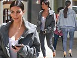 UK CLIENTS MUST CREDIT: AKM-GSI ONLY\nEXCLUSIVE: Kim Kardashian was spotted out walking in Beverly Hills, CA on Monday afternoon, unusually dressed down for one of her outings. The reality starlet donned a simple white wifebeater, skinny jeans and an oversized men's hoodie, carrying only her phone.\n\nPictured: Kim Kardashian\nRef: SPL993172  060415   EXCLUSIVE\nPicture by: AKM-GSI / Splash News\n\n