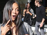 Beverly Hills, CA - Actress, Zoe Saldana, appeared to be giddy after having lunch at Frida Restaurant with her husband, Marco Perego.  She was dressed in a gray cardigan, a wrap shirt, black capri pants, and black sandals.\nAKM-GSI        April 6, 2015\nTo License These Photos, Please Contact :\nSteve Ginsburg\n(310) 505-8447\n(323) 423-9397\nsteve@akmgsi.com\nsales@akmgsi.com\nor\nMaria Buda\n(917) 242-1505\nmbuda@akmgsi.com\nginsburgspalyinc@gmail.com