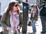 Geri Halliwell out in North London\nFeaturing: Geri Halliwell\nWhere: London, United Kingdom\nWhen: 07 Apr 2015\nCredit: WENN.com\nCaption - Geri Halliwell is assisted by a ticket inspector in paying for parking at a ticket machine in North London after initially forgetting her registration number.