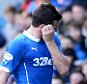 05/04/15 SCOTTISH CHAMPIONSHIP RANGERS v HEARTS IBROX - GLASGOW Dejection for Rangers captain Lee McCulloch after being sent off