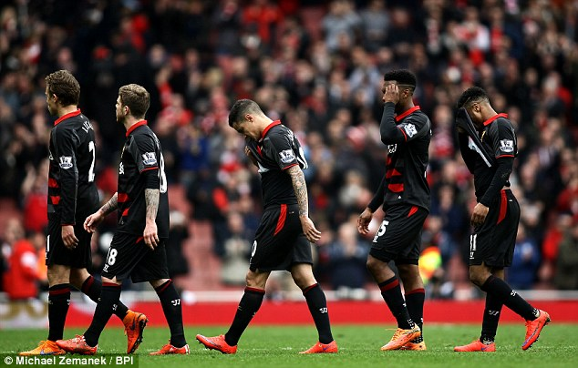 Liverpool players leave the pitch after the 4-1 defeat against Arsenal on Saturday afternoon