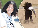 Please contact X17 before any use of these exclusive photos - x17@x17agency.com   Kylie and Kendall Jenner have a photoshoot in Malibu and in between takes talk up some bikin clad babes who look like they are fans. April 7, 2015 X17online.com