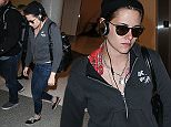 Kristen Stewart seen at LAX Airport on April 7, 2015 in Los Angeles, California, United States. \n\nPictured: Kristen Stewart\nRef: SPL994010  070415  \nPicture by: XC/PapJuice.com/Splash News\n\nSplash News and Pictures\nLos Angeles: 310-821-2666\nNew York: 212-619-2666\nLondon: 870-934-2666\nphotodesk@splashnews.com\n
