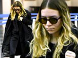 One of the Olsen Twins arriving at JFK airport in New York. 7 April 2015. \n7 April 2015.\nPlease byline: Vantagenews.co.uk