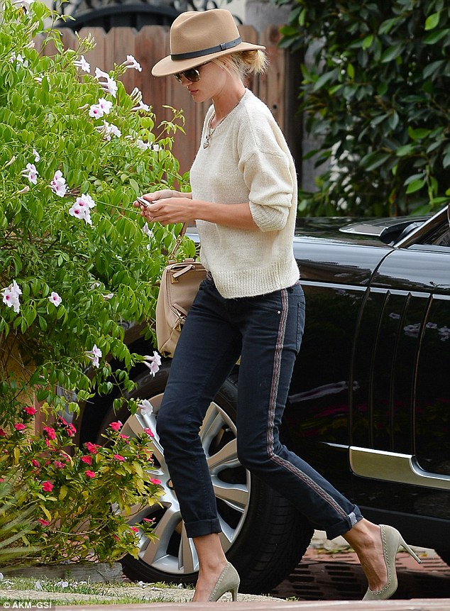 Guess who's coming to dinner: Rosie Huntington-Whiteley visited friends in Los Angeles on Tuesday