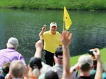 AUGUSTA, GA - APRIL 08:  Patrons watch as Jack Nicklaus celebrates his hole-in-one on the fourth hole during the Par 3 Contest prior to the start of the 2015 Masters Tournament at Augusta National Golf Club on April 8, 2015 in Augusta, Georgia.  (Photo by David Cannon/Getty Images)