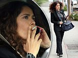 EXCLUSIVE: Actress Salma Hayek enjoys a cigarette and chats on her cellphone while she is driven around town and runs errands in West Hollywood, Ca\n\nPictured: Salma Hayek\nRef: SPL993960  070415   EXCLUSIVE\nPicture by: GoldenEye /London Entertainment\n\nSplash News and Pictures\nLos Angeles: 310-821-2666\nNew York: 212-619-2666\nLondon: 870-934-2666\nphotodesk@splashnews.com\n