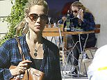 Picture Shows: Elizabeth Berkley  April 08, 2015\n \n Actress and busy mom Elizabeth Berkley stops for an early dinner at Le Pain Quotidien in Studio City, California. \n \n Not even dinner could keep Elizabeth off her phone and handling business.\n \n Exclusive - All Round\n UK RIGHTS ONLY\n \n Pictures by : FameFlynet UK © 2015\n Tel : +44 (0)20 3551 5049\n Email : info@fameflynet.uk.com