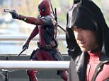 "Picture Shows: Ryan Reynolds  April 08, 2015\n \n Actor Ryan Reynolds briefly shows his face while filming action scenes for ""Deadpool"" in Vancouver, Canada. The new Marvel movie tells the story of a former Special Forces operative turned mercenary who is subjected to a rogue experiment that leaves him with accelerated healing powers.\n \n Exclusive All Rounder\n UK RIGHTS ONLY\n Pictures by : FameFlynet UK © 2015\n Tel : +44 (0)20 3551 5049\n Email : info@fameflynet.uk.com"