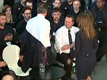 DM VIDEOGRAB CREDIT BBC 09/04/2015 Karren Brady helps David Cameron with his jacket as he stands to speak at launch of apprentice scheme