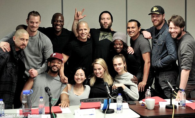 All together: The cast and director of Suicide Squad movie posed for a photo  on earlier this month (clockwise from left - David Ayer, Joel Kinnaman, Adewale Akinnoye-Agbaje, Jay Hernandez, Jai Courtney, Viola Davis, Adam Beach, Jim Parrack, Ike Barinholtz, Cara Delevingne, Margot Robbie, Karen Fukuhara, and Will Smith)
