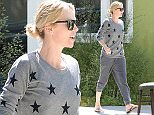 UK CLIENTS MUST CREDIT: AKM-GSI ONLY\nEXCLUSIVE: Charlize Theron proved she looks just as good in her sweatpants as she does all done up for the red carpet on Wednesday, when she was spotted running some errands in Hollywood. The natural beauty looked lovely, wearing a simple pair of grey sweats and a star-print sweatshirt, topped off with brown flip flops and her short hair in a bun.\n\nPictured: Charlize Theron\nRef: SPL994440  080415   EXCLUSIVE\nPicture by: AKM-GSI / Splash News\n\n