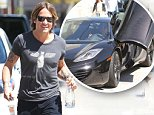 UK CLIENTS MUST CREDIT: AKM-GSI ONLY..EXCLUSIVE: Australian multi-talented musician Keith Urban seen leaving a business meeting in Los Angeles, CA this afternoon, wearing a flying rat tee, dark jeans and gray sneakers. The happy man couldn't look any cooler, driving off on a black Mclaren sports car.....Pictured: Keith Urban..Ref: SPL994462  080415   EXCLUSIVE..Picture by: AKM-GSI / Splash News....