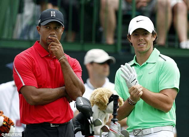 Woods with McIlroy at the tee of the 12th hole final round of the Memorial Tournament in 2013