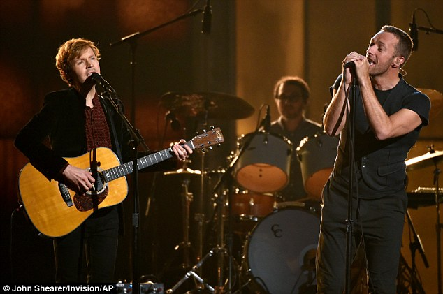 'Heart is a Drum' Beck (L) and Chris Martin (R) took to the Grammys stage to perform on Sunday night