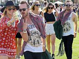"""Indio, CA -  Aaron Paul is the life of the party as he hangs with his ladies on the first day of the Coachella Music Festival held in the Empire Polo Club in Indio, CA. Aaron was joined by the sexy Julianne Hough from 'Dancing With The Stars"""". \nAKM-GSI       April  10, 2015\nTo License These Photos, Please Contact :\nSteve Ginsburg\n(310) 505-8447\n(323) 423-9397\nsteve@akmgsi.com\nsales@akmgsi.com\nor\nMaria Buda\n(917) 242-1505\nmbuda@akmgsi.com\nginsburgspalyinc@gmail.com"""