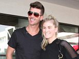 """Robin Thicke greets some young eager female fans as he arrives in Los Angeles.  The """"Blurred Lines"""" singer was seen at LAX making his way to a waiting limo, but first took photos with the waiting fans.   Pictured: Robin Thicke Ref: SPL995446  090415   Picture by: Splash News  Splash News and Pictures Los Angeles: 310-821-2666 New York: 212-619-2666 London: 870-934-2666 photodesk@splashnews.com"""