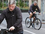 New York, NY - Alec Baldwin walks his bike home after getting a flat tire while out on a morning ride in New York. Karma must be getting back at the star, Alec was in a coffee shop grabbing a morning cup when a fan asked to take a picture with him, Alec declined and the fan got angry, following Baldwin to the street and talking trash about him while holding up a middle finger to his back as Alec pushed his bike towards home.\nAKM-GSI       April  9, 2015\nTo License These Photos, Please Contact :\nSteve Ginsburg\n(310) 505-8447\n(323) 423-9397\nsteve@akmgsi.com\nsales@akmgsi.com\nor\nMaria Buda\n(917) 242-1505\nmbuda@akmgsi.com\nginsburgspalyinc@gmail.com