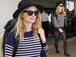 LOS ANGELES, CA - APRIL 09: Heather Graham is seen at LAX on April 09, 2015 in Los Angeles, California.  (Photo by GVK/Bauer-Griffin/GC Images)
