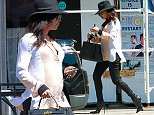 UK CLIENTS MUST CREDIT: AKM-GSI ONLY\nEXCLUSIVE: Pregnant Naya Rivera  feeds her pregnancy cravings with a healthy lunch at Real Food Daily, Organic Vegan Cuisine in West Hollywood. The 'Devious Maids' star looked fashionable in a black large brimmed hat, black denim skinnies, black leather heels and a loose top to conceal her growing baby bump as she went to lunch alone in the city.\n\nPictured: Naya Rivera\nRef: SPL995187  090415   EXCLUSIVE\nPicture by: AKM-GSI / Splash News\n\n