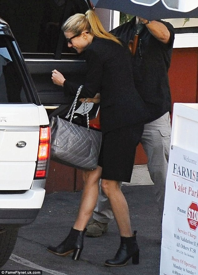 Leggy display: She showed off her fabulous pins in a pair of smart knee-length shorts and chunky heeled ankle boots as she made her way to her car