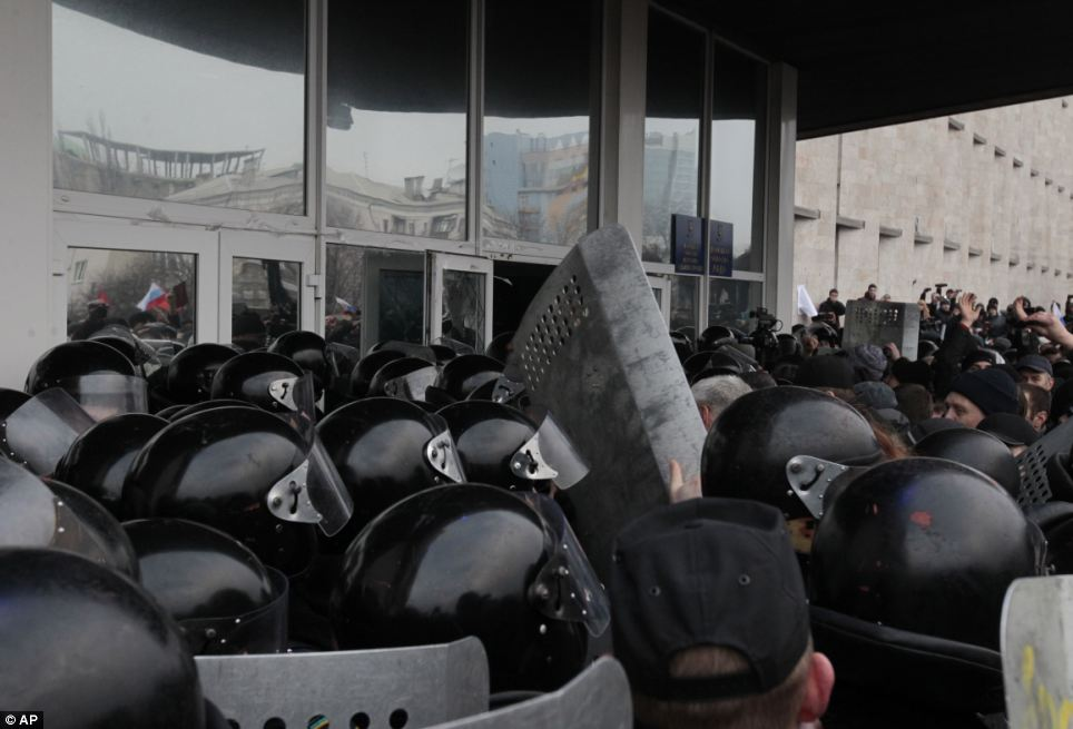 Force: Demonstrators waving Russian flags smashed their way into the regional administrative building