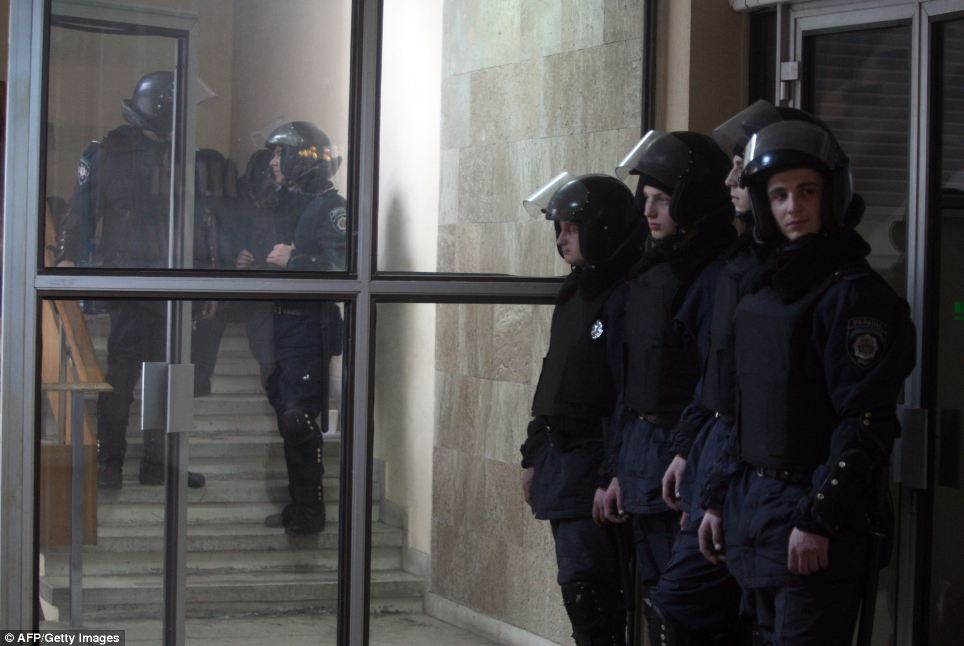 Guard: Policemen stand inside the regional state administration building in the Ukrainian eastern industrial city of Donetsk