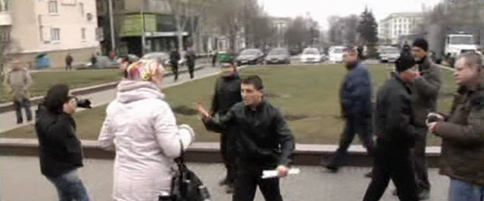 Striking back: Still clutching her handbag, the woman remonstrated with the younger man