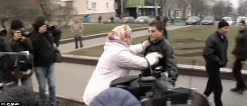 Audience: The scuffle took place in front of riot police in the eastern city of Donetsk