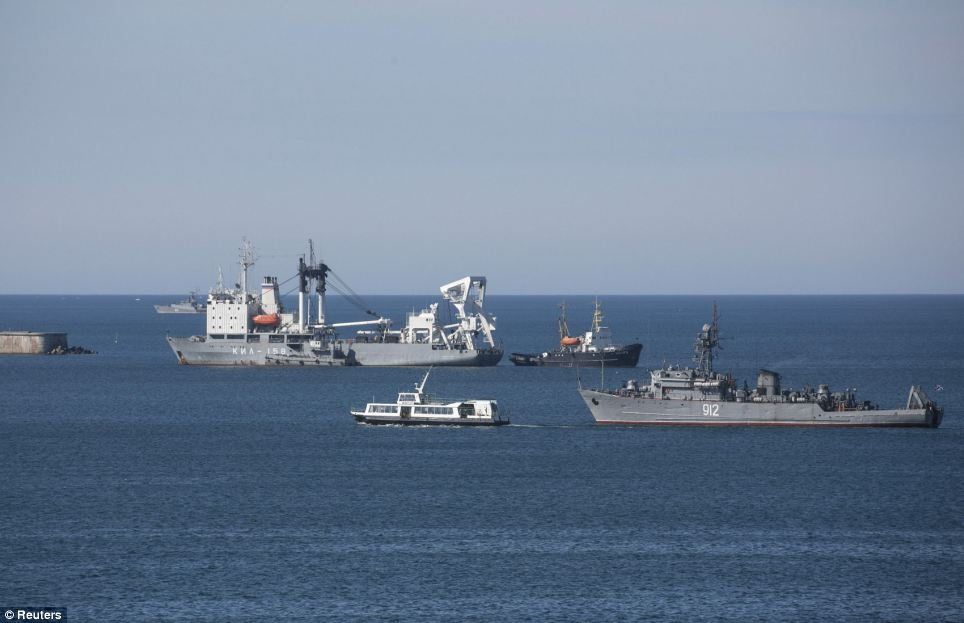 Not getting through: Russian Navy ships block the entrance to the strategically important Crimean port of Sevastopol earlier today