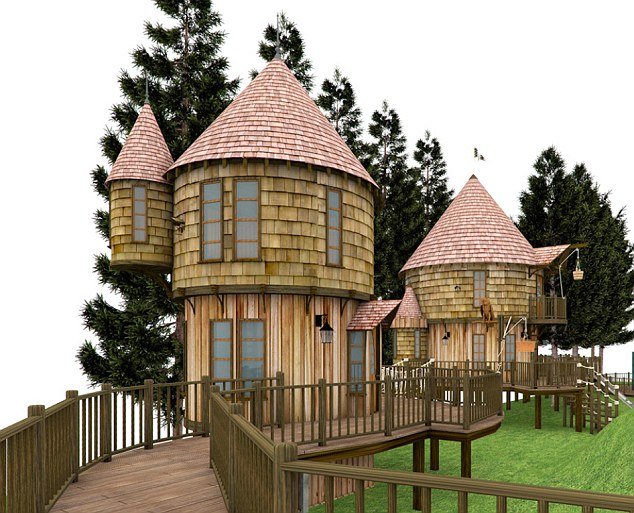 Victory: Harry Potter author JK Rowling has won a battle to build two luxury tree houses in the garden of her home despite protests from local residents. This picture shows a computer simulation of the twin tree houses