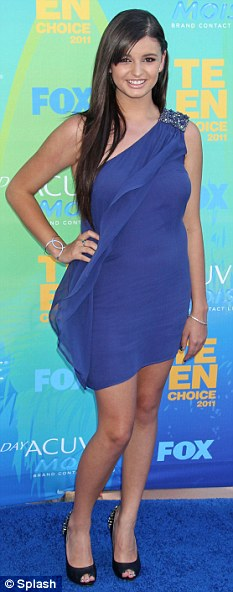 Not happy: Rebecca Black, seen here at the Teen Choice Awards, has been pulled out of school due to bullying
