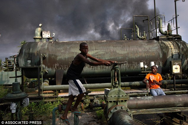 Looted: Allegations include the plundering of revenues from oil in Nigeria (pictured in file photo)